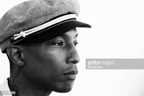 Pharrell Williams poses for a photo on the balcony of the palais during the Cannes Lions Festival on June 23 2015 in Cannes France