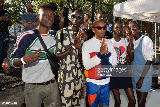 Pharrell Williams poses with campaign moddels during adidas Tennis Pharrell Williams Don't Be Quiet Please Event at Frederick Johnson Tennis Courts...