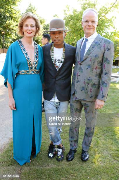Pharrell Williams poses with codirectors of the Serpentine Gallery Julia PeytonJones and HansUlrich Obrist attend The Serpentine Gallery Summer Party...