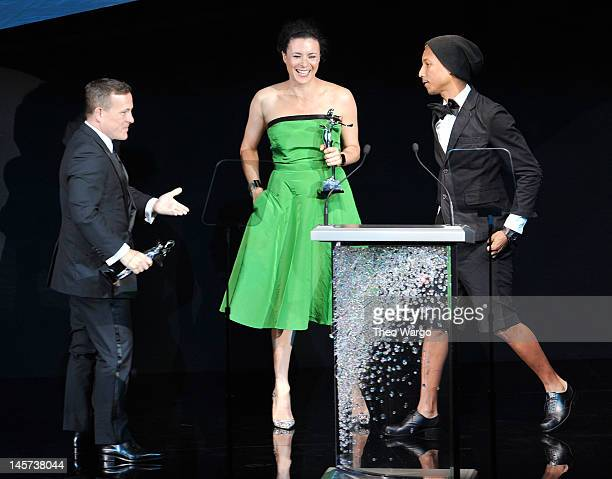 Pharrell Williams presents CFDA Media Award to Scott Schuman and Garance Dore on stage at the 2012 CFDA Fashion Awards at Alice Tully Hall on June 4...