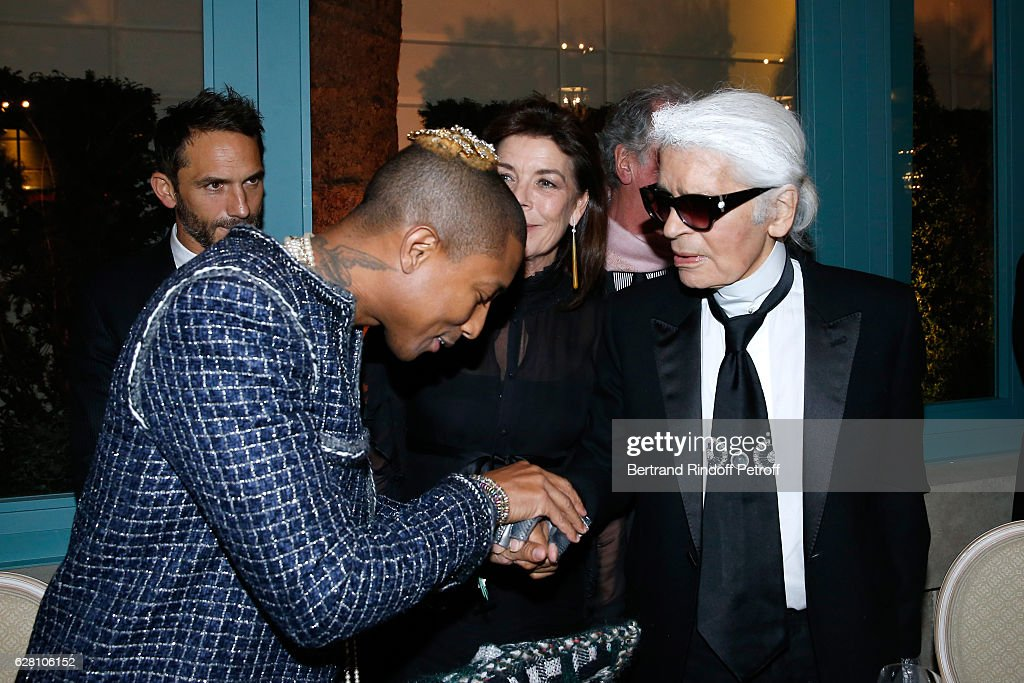 Pharrell Williams, Princess Caroline de Hanovre and stylist Karl Lagerfeld attend the 'Chanel Collection des Metiers d'Art 2016/17 : Paris Cosmopolite'