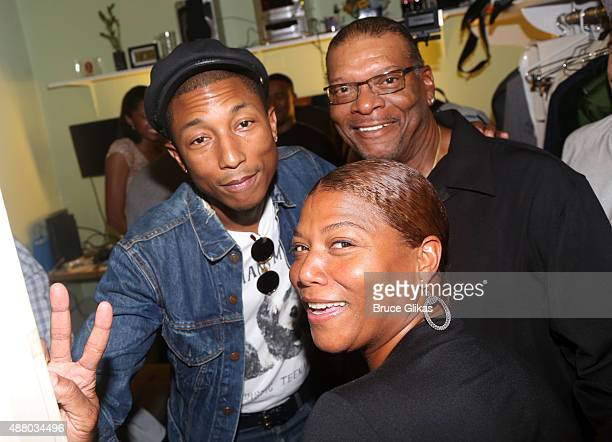 Pharrell Williams Queen Latifah and her father Lancelot Owens Sr pose backstage at the hit musical Hamilton on Broadway at The Richard Rogers Theater...