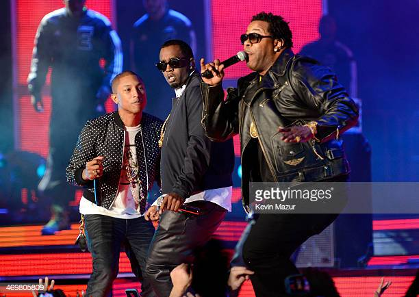 Pharrell Williams Sean Combs and Busta Rhymes perform onstage at the 63rd NBA AllStar Game 2014 at the Smoothie King Center on February 16 2014 in...