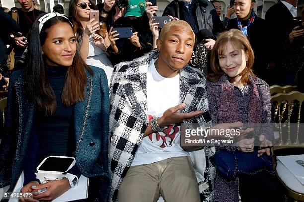 Pharrell Williams sitting between his wife Helen Lasichanh and Isabelle Huppert attend the Chanel show as part of the Paris Fashion Week Womenswear...