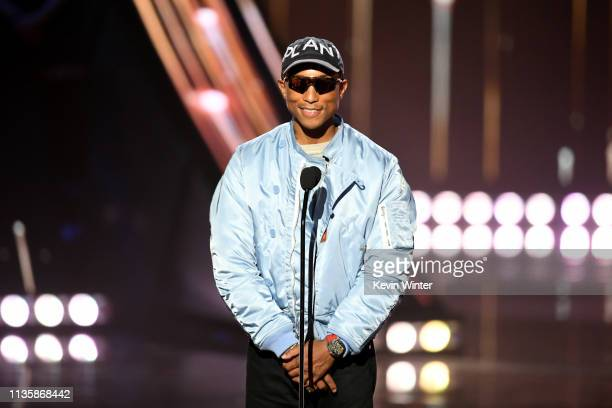 Pharrell Williams speaks on stage at the 2019 iHeartRadio Music Awards which broadcasted live on FOX at the Microsoft Theater on March 14 2019 in Los...