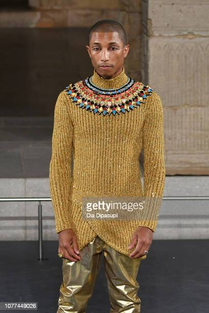 Pharrell Williams walks the runway at Chanel Metiers D'Art 2018/19 Show at The Metropolitan Museum of Art on December 04 2018 in New York City