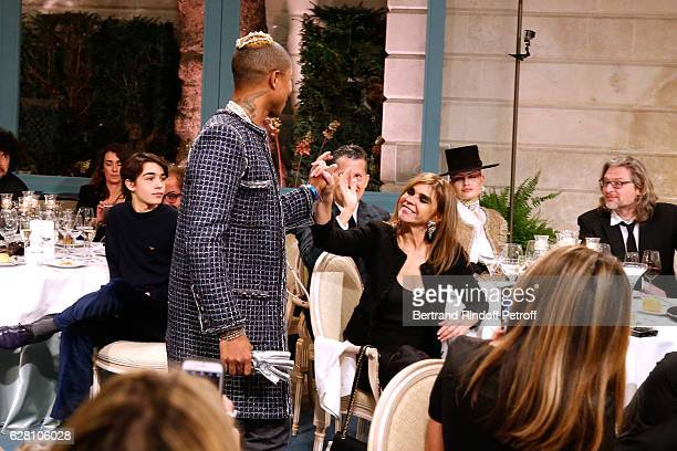 Pharrell Williams walks the runway in front of Carine Roitfeld during the 'Chanel Collection des Metiers d'Art 2016/17 Paris Cosmopolite' Show at...