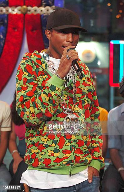 Pharrell Williams wearing a necklace designed by Jacob Co