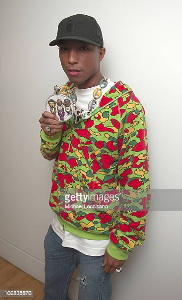 Pharrell Williams wearing a necklace designed by Jacob the Jeweler