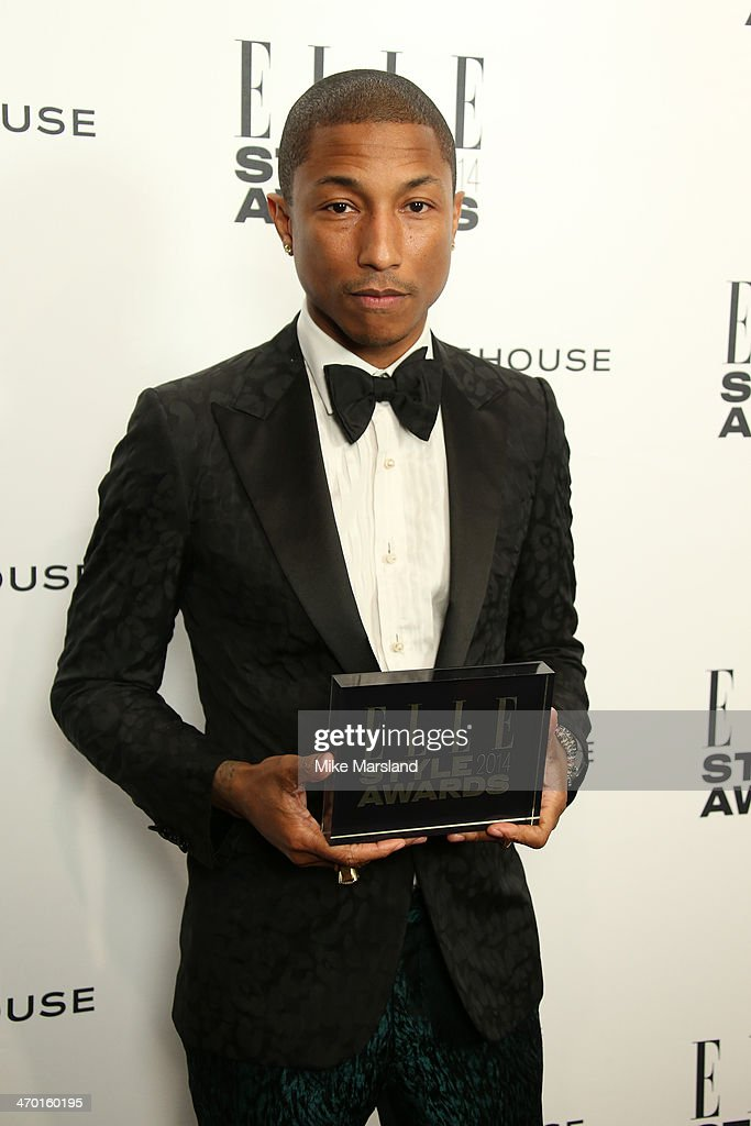 Pharrell Williams, winner of the International Recording Artist Award, poses in the winners room at the Elle Style Awards 2014 at one Embankment on February 18, 2014 in London, England.