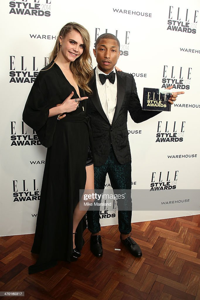 Pharrell Williams, winner of the International Recording Artist Award, poses in the winners room with model and presenter Cara Delevingne at the Elle Style Awards 2014 at one Embankment on February 18, 2014 in London, England.