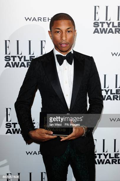 Pharrell Williams with the awrad for International Recording Artist of the Year at the 2014 Elle Style Awards at The One Embankment London