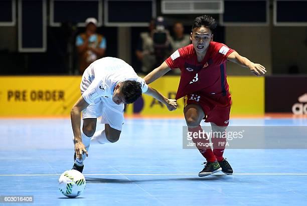 Phat Danh of Vietnam holds off Roman Alvarado of Guatemala during the FIFA Futsal World Cup Group C match between Vietnam and Guatemala at Coliseo el...