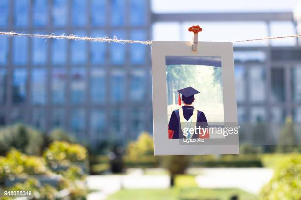 Ph.D student graduation picture hanging on a string