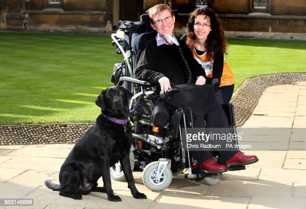 PhD student Jonathan Gilmour who has Duchenne muscular dystrophy with his assistance dog Uri and fund raiser Albertyna Paciorek in the court yard of...