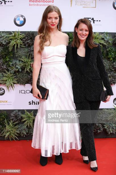 Pheline Roggan and Lavinia Wilson attend the Lola German Film Award red carpet at Palais am Funkturm on May 03 2019 in Berlin Germany