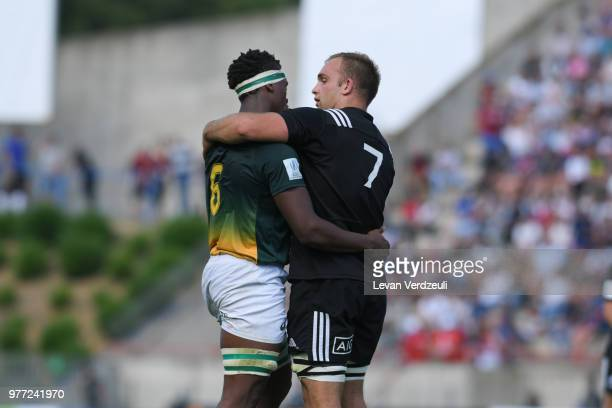Phendulani Buthelezi of South Africa and Tom Christie of New Zealand have a conversation after the final whistle of the World Rugby Under 20...