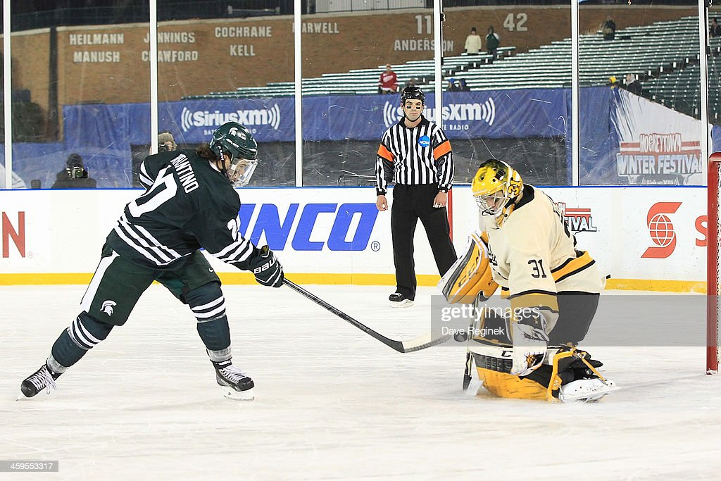 Pheonix Copley #31 of the Michigan Tech Huskies makes a shoot-out save on Michael Ferrantino #20 of Michigan State Spartans crashes the net during game one of the Hockeytown Winter Festival Great Lakes Invitational - Day 1 played outdoors at Comerica Park on December 27, 2013 in Detroit, Michigan. The Huskies won in a shoot-out 3-2