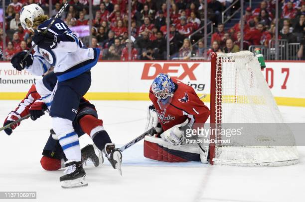 Pheonix Copley of the Washington Capitals makes a save against the Winnipeg Jets in the second period at Capital One Arena on March 10 2019 in...