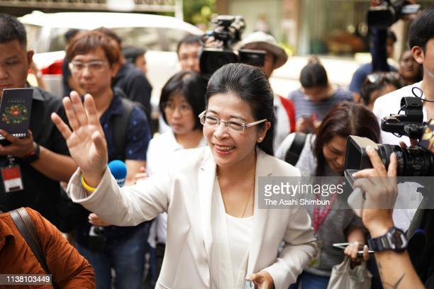 Pheu Thai party candidate for prime minister Sudarat Keyuraphan waves after casting a ballot on March 24 2019 in Bangkok Thailand Around 50 million...