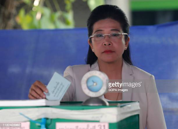 Pheu Thai Party leader and candidate for prime minister Sudarat Keyuraphan drops her vote into a ballot box during Thailand's general election in...