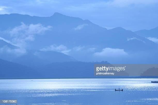 phewa lake in pokhara, nepal. - pokhara stock pictures, royalty-free photos & images