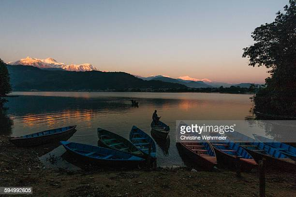 phewa lake, pohkara at sunset - christine wehrmeier stock photos and pictures