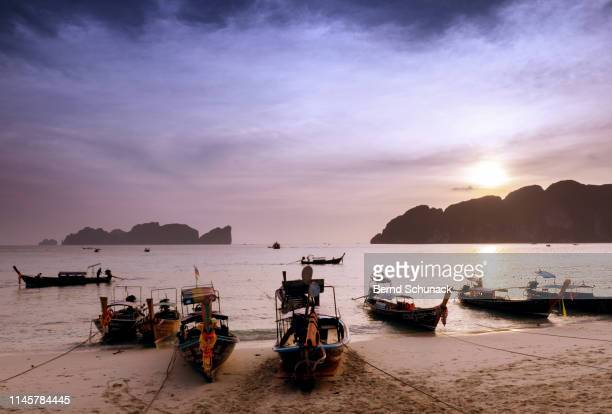 phi phi islands sunset - bernd schunack stock photos and pictures