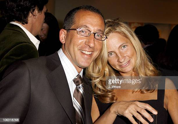 """Phil Alberstat and Holly Wiersma during Damian Elwes """"Inside Picasso's Studio"""" Art Exhibition at M+B in West Hollywood, California, United States."""
