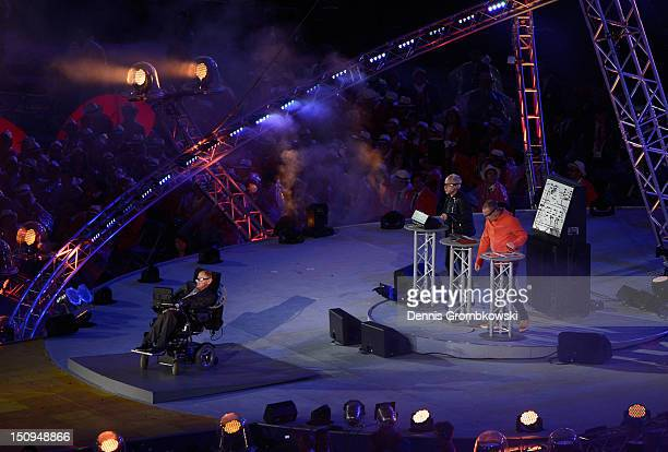 Phil and Paul Hartnoll of Orbital perform with Professor Stephen Hawking during the Opening Ceremony of the London 2012 Paralympics at the Olympic...
