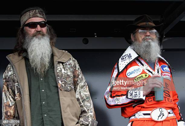 Phil and Si Robertson take part in prerace ceremonies for the NASCAR Sprint Cup Series Duck Commander 500 at Texas Motor Speedway on April 6 2014 in...