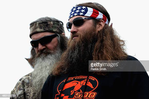Phil and Willie Robertson take part in prerace ceremonies for the NASCAR Sprint Cup Series Duck Commander 500 at Texas Motor Speedway on April 6 2014...