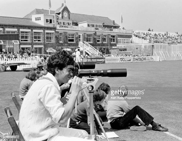 Phil Bainbridge of Gloucestershire taking photographs from the boundary during the tour match between Gloucestershire and West Indies at Bristol 2nd...