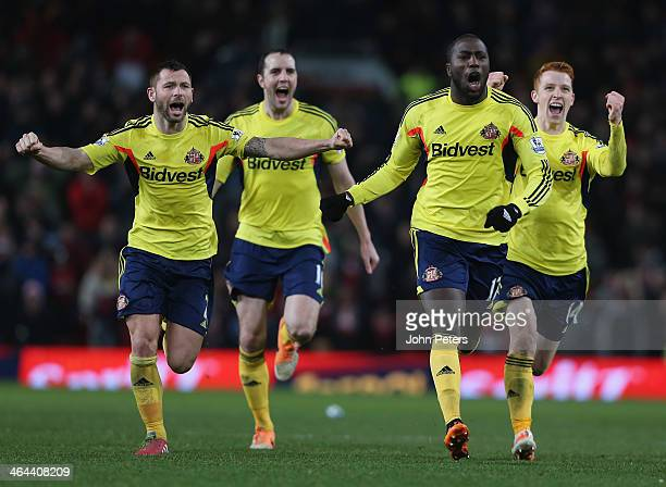 Phil Bardsley John O'Shea Jozy Altidore and Jack Colback of Sunderland celebrate at the end of during the Capital One Cup semifinal second leg at Old...