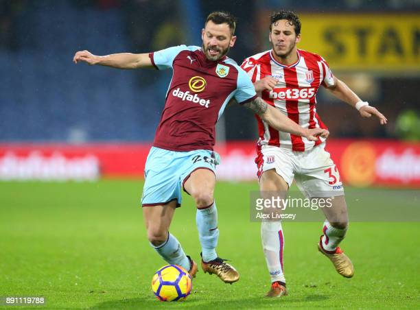 Phil Bardsley of Burnley and Ramadan Sobhi of Stoke City during the Premier League match between Burnley and Stoke City at Turf Moor on December 12...