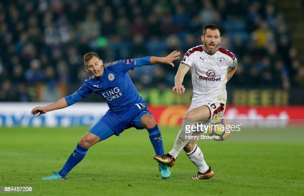 Phil Bardsley of Burnley attempts to get away from Marc Albrighton of Leicester City during the Premier League match between Leicester City and...