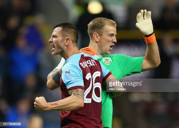 Phil Bardsley of Burnley celebrates with Joe Hart at the final whistle during the UEFA Europa League third round qualifier second leg between Burnley...