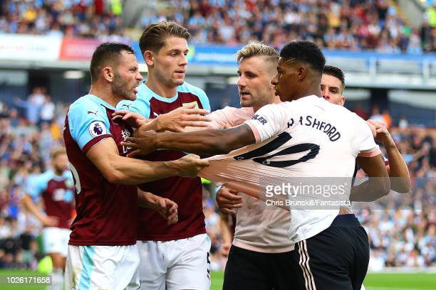 Phil Bardsley of Burnley clashes with Marcus Rashford of Manchester United during the Premier League match between Burnley FC and Manchester United...