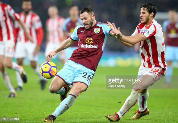 Phil Bardsley of Burnley holds off Josh Tymon of Stoke City during the Premier League match between Burnley and Stoke City at Turf Moor on December...