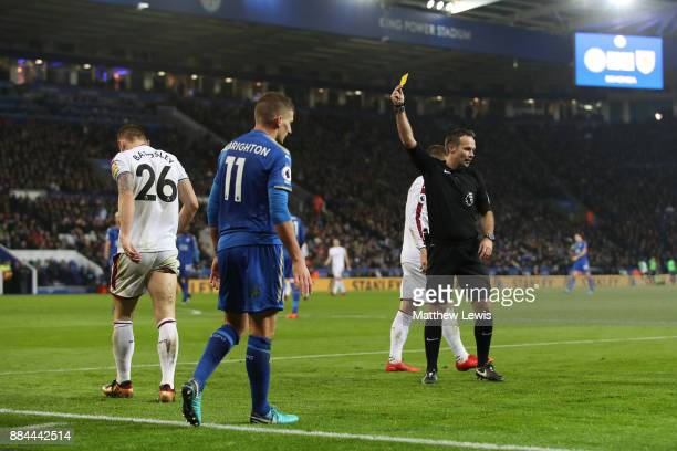 Phil Bardsley of Burnley is booked for a foul on Marc Albrighton of Leicester City during the Premier League match between Leicester City and Burnley...