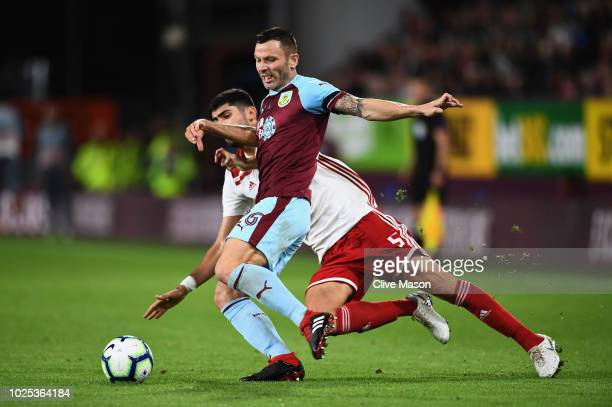 Phil Bardsley of Burnley is challenged by Andreas Bouchalakis of Olympiakos during the UEFA Europa League qualifing second leg play off match between...