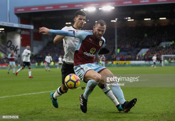 Phil Bardsley of Burnley is challenged by Dominic Solanke of Liverpool during the Premier League match between Burnley and Liverpool at Turf Moor on...