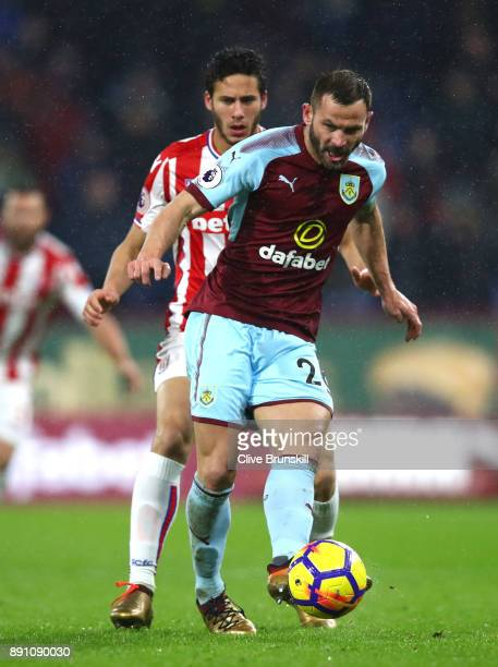 Phil Bardsley of Burnley passes the ball under pressure from Ramadan Sobhi of Stoke City during the Premier League match between Burnley and Stoke...