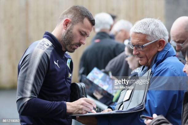 Phil Bardsley of Burnley signs autographs prior to the Premier League match between Burnley and West Ham United at Turf Moor on October 14 2017 in...