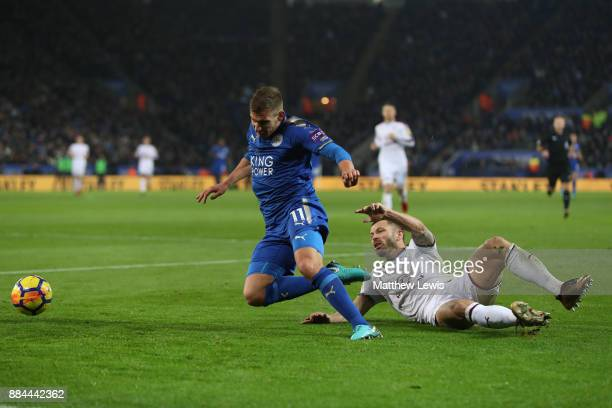 Phil Bardsley of Burnley tackles Marc Albrighton of Leicester City during the Premier League match between Leicester City and Burnley at The King...