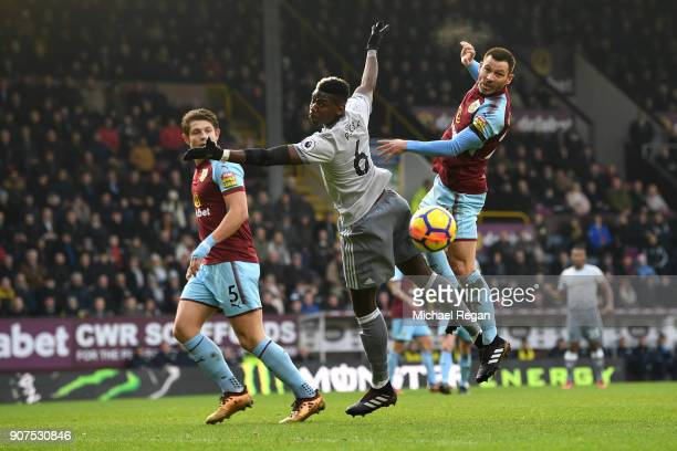 Phil Bardsley of Burnley wins a header over Paul Pogba of Manchester United during the Premier League match between Burnley and Manchester United at...