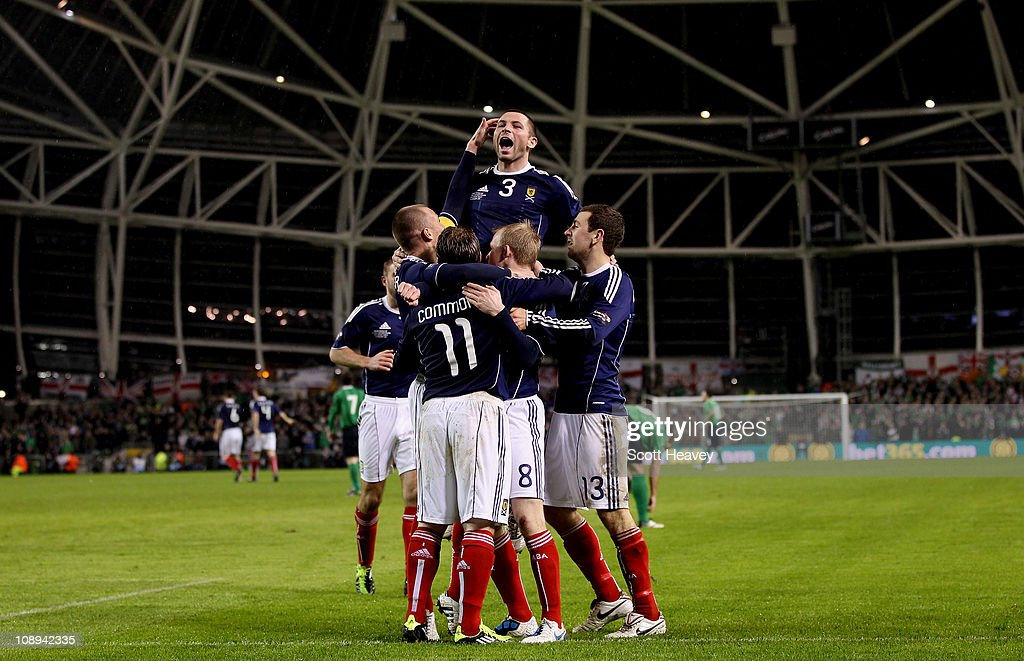 Phil Bardsley of Scotland celebrates after Kris Commons (No.11) scored their third goal during the Carling Nations Cup match between Northern Ireland and Scotland at the Aviva Stadium on February 9, 2011 in Dublin, Ireland.