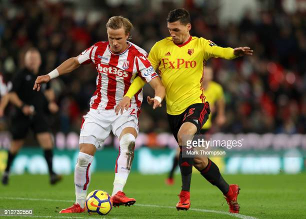 Phil Bardsley of Stoke City battles for possesion with Craig Cathcart of Watford during the Premier League match between Stoke City and Watford at...