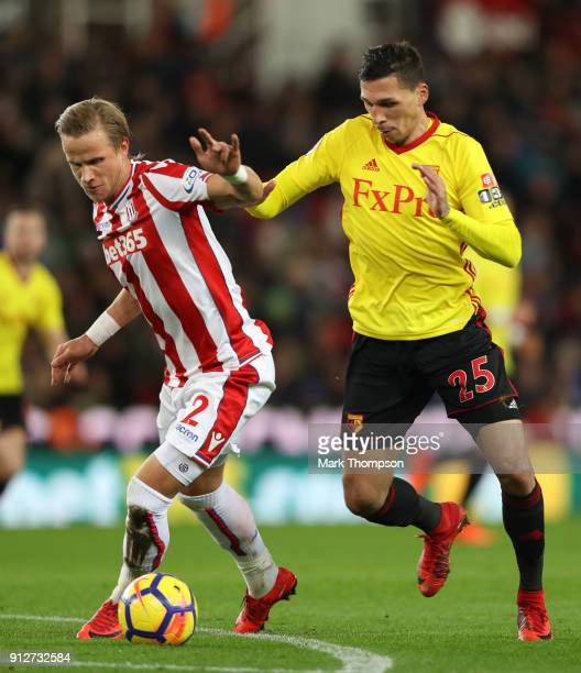 Phil Bardsley of Stoke City battles for possesion with Jose Holebas of Watford during the Premier League match between Stoke City and Watford at...