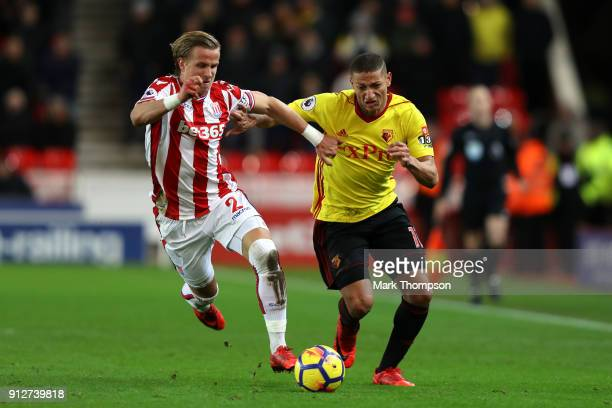 Phil Bardsley of Stoke City battles for possesion with Richarlison de Andrade of Watford during the Premier League match between Stoke City and...